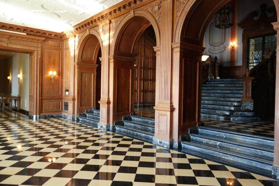 The grand hall and staircase at Greystone Mansion