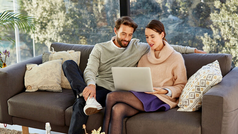 couple on couch with laptop