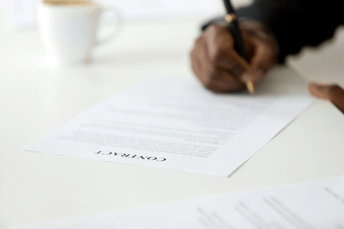 person signing a 6-month lease apartments rental contract